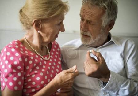 wife giving pill to husband