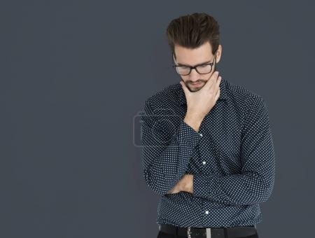 Businessman thinking and holding hand on chin