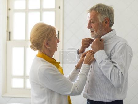 Senior woman Helping senior man