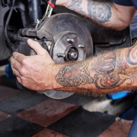 man repairing broken wheel