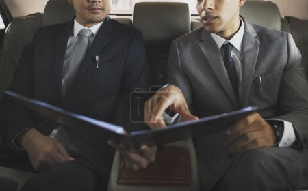 Businessmen holding folder