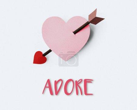 paper heart shape and arrow
