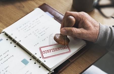 Man putting stamp on paper