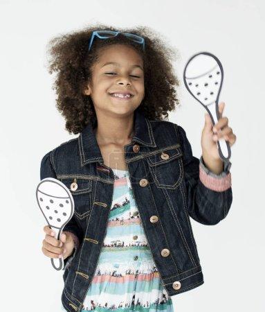 kid holding fake maracas