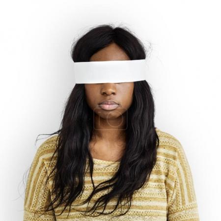 Woman with bandage on eyes