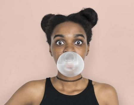 young African woman with chewing gum