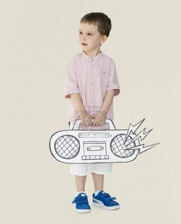 Boy holding record player