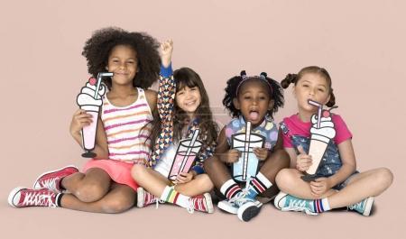 mixed ethnicity children with beverages