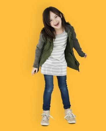 girl in coat dancing in studio