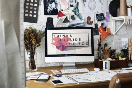 Computer monitor at fashion designer workplace