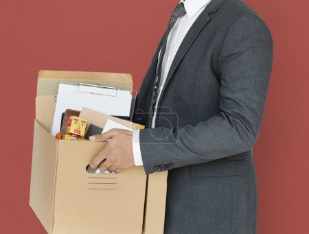 Studio Portrait of Businessman with box