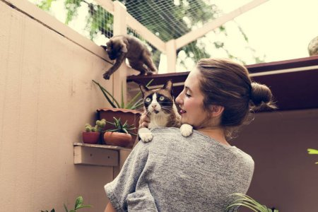 Woman Playing With Cats