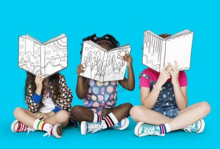 mixed ethnicity children with books