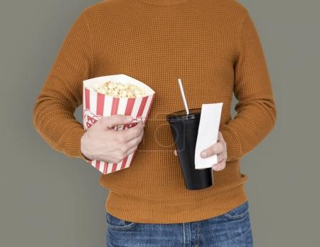 man with popcorn and drink