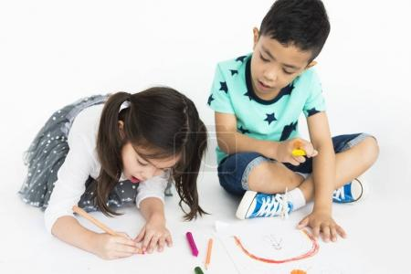 Children drawing with pencils