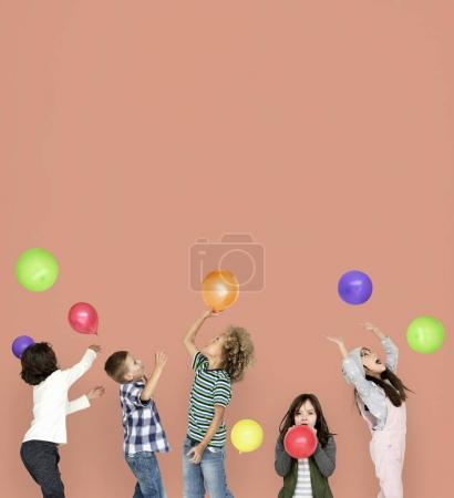 Children playing with colorful balloons