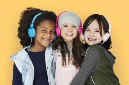 Cheerful girls listening music