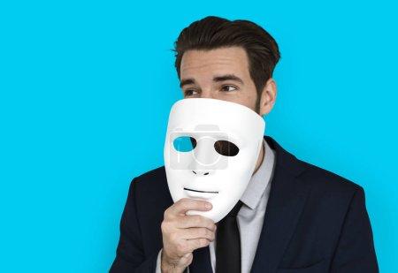 Businessman holding masks