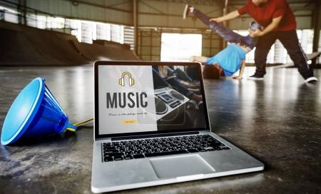 Two guys dancing against laptop