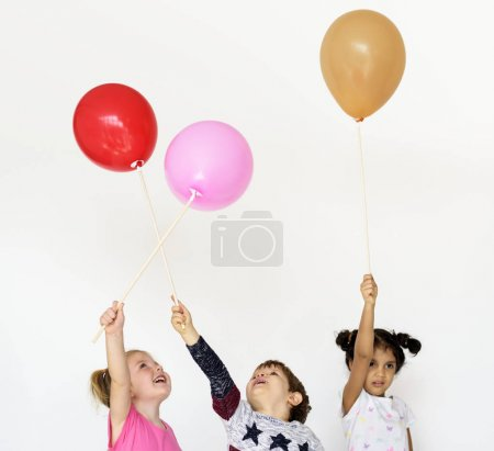 Little Children Playing with Balloons