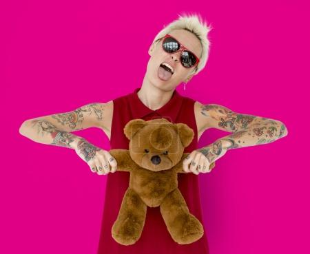 Blonde Woman with tattoos and teddy bear