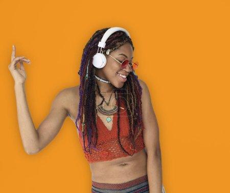 african woman with dreadlocks listening music