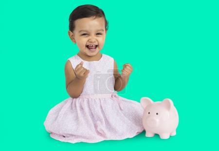 asian little girl with piggy bank
