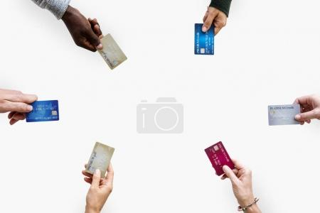 Group of hands holding credit cards