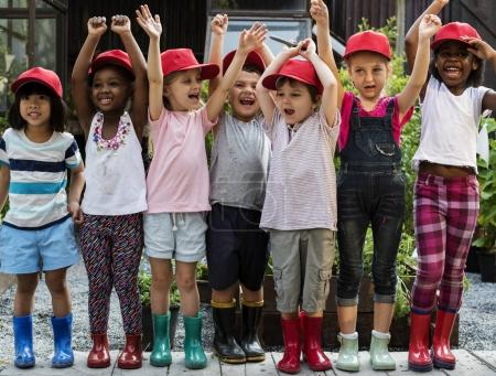 Group of kindergarten kids in red caps