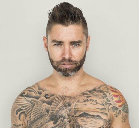 shirtless tattooed man