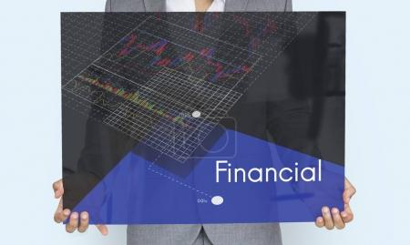 Mid section of businesswoman holding banner