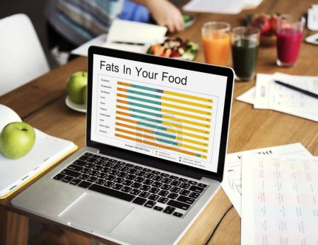 laptop on table with diet food