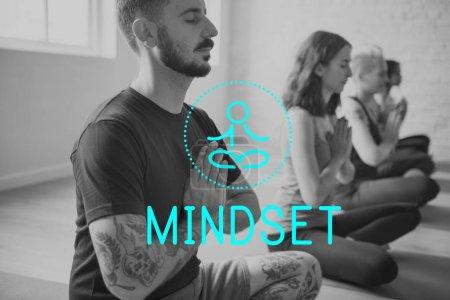 Young adults doing yoga and meditating