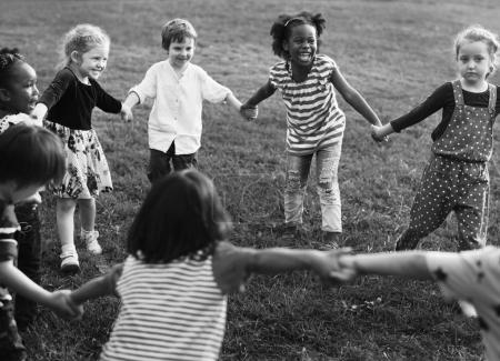 Group of kindergarten playing at park