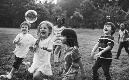 kindergarten kids playing blowing bubbles