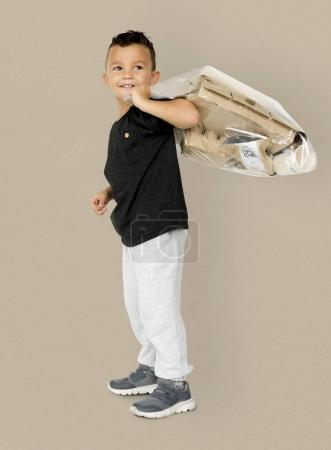 Boy Holding Separate Papers
