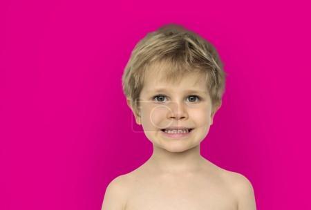 Boy in studio posing shirtless