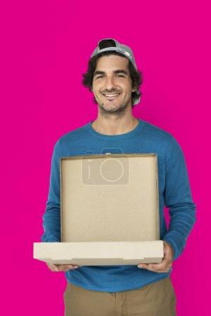 Man carrying pizza box