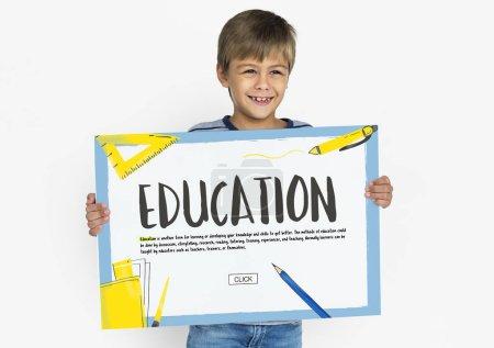 boy holding placard