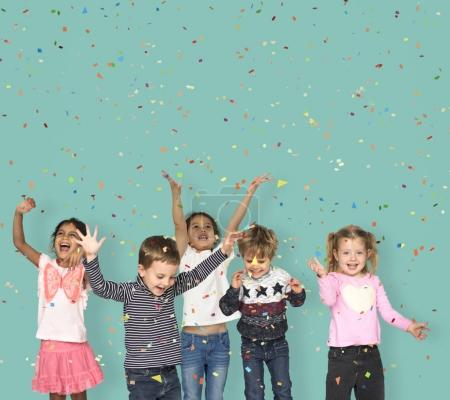 adorable children jumping in studio