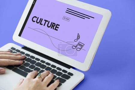 woman typing on laptop keyboard