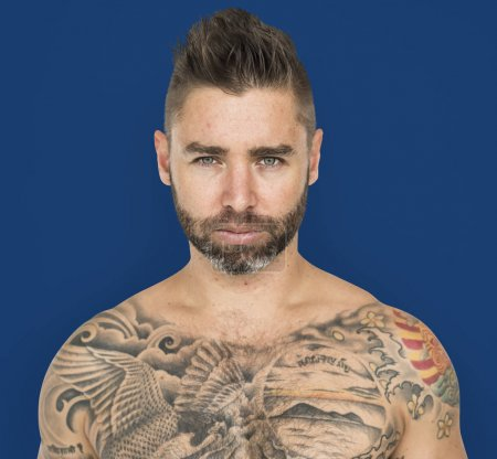 shirtless man with tattooes