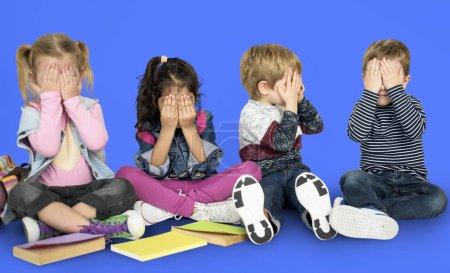 Little Children Covering Faces