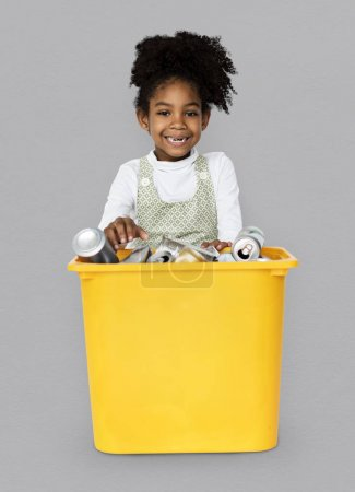 Girl Separating Recyclable Cans