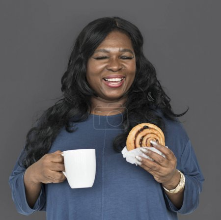 woman with coffee and pastry