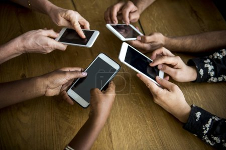 Group of people using mobile phones