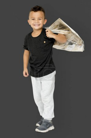 boy with bag of paper garbage