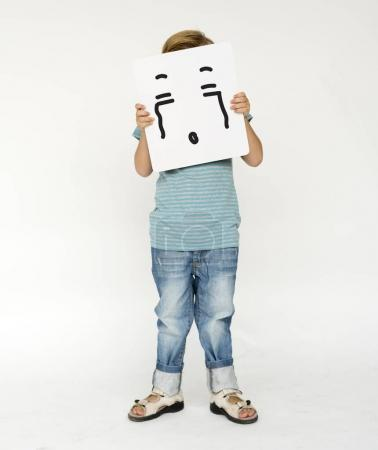 little kid covering face