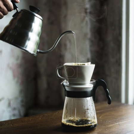 barista with coffee pot pouring hot coffee, drip coffee concept, original photoset