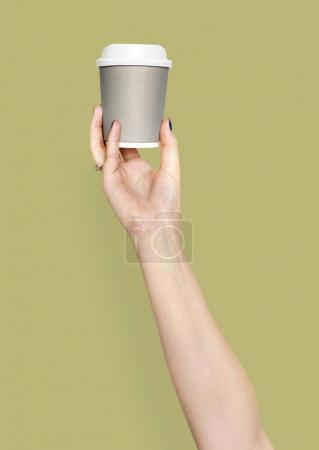 Hand holding variation of coffee cup